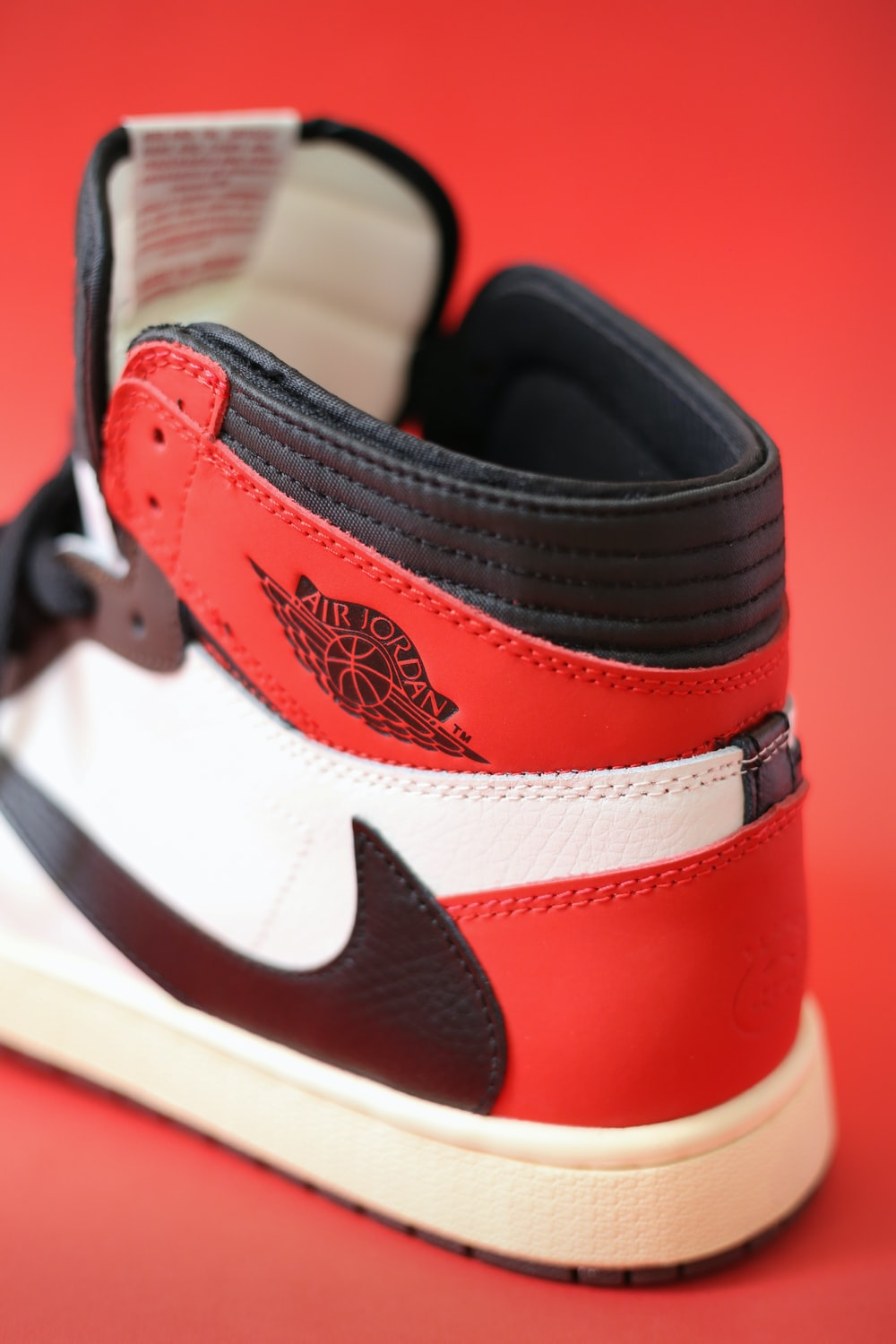 red and white nike high top sneakers