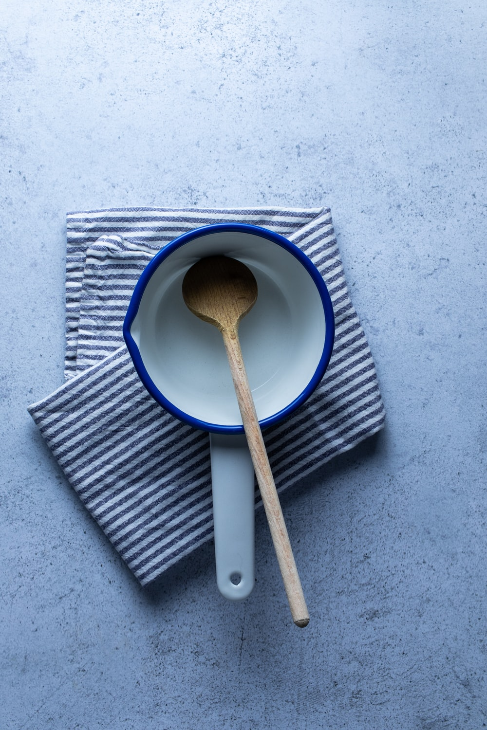 brown wooden spoon on white and blue ceramic plate