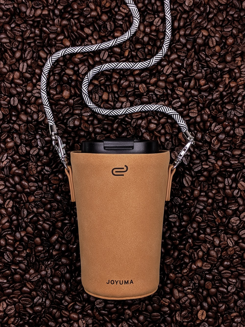brown and black leather handbag