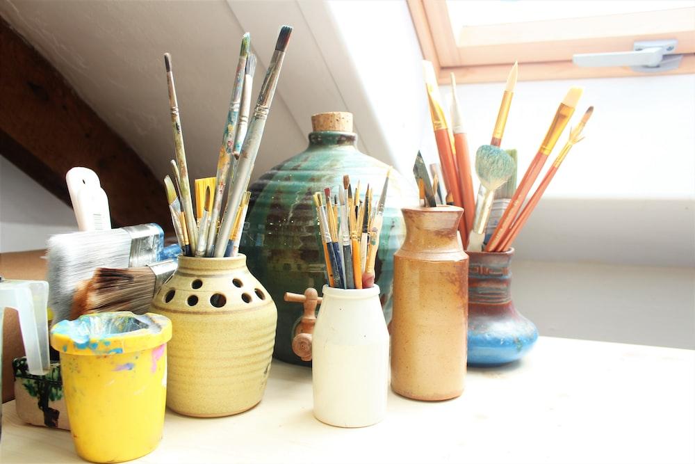 white ceramic jars on white table