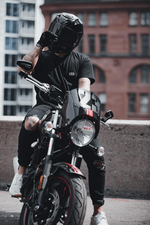 man in black helmet riding motorcycle
