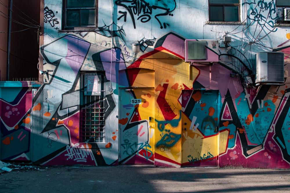 graffiti art on wall during daytime