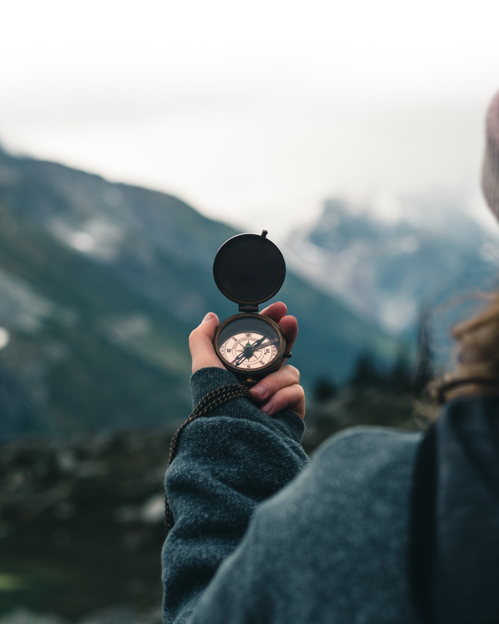 person holding black round container