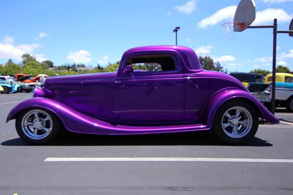purple chevrolet crew cab pickup truck on road during daytime