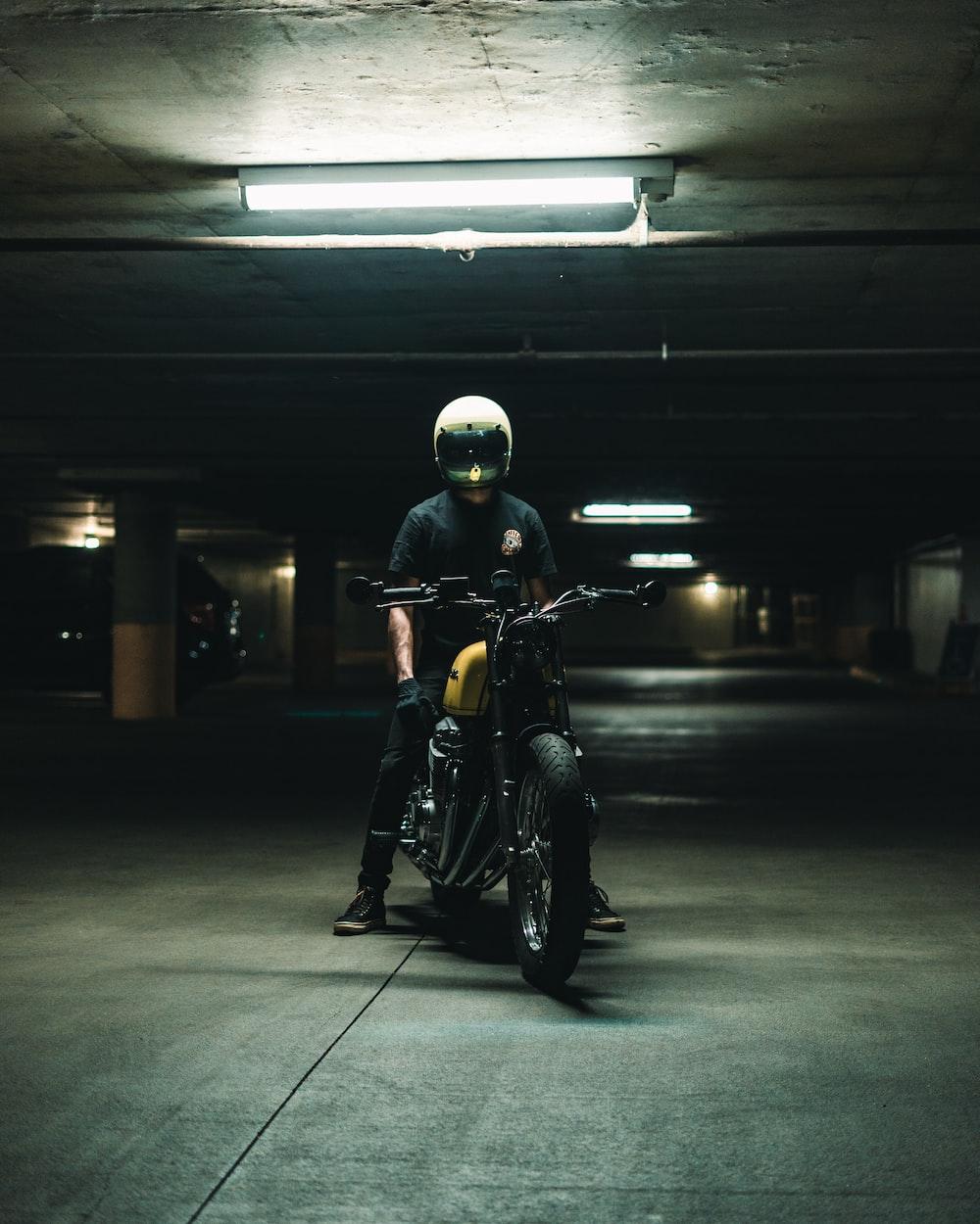 man in black jacket riding motorcycle