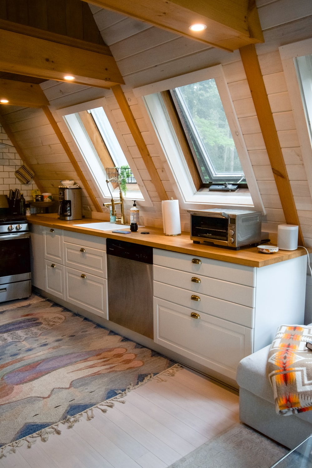 white microwave oven on white wooden cabinet