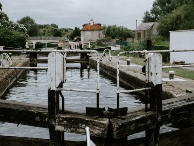 white and brown wooden dock on river during daytime