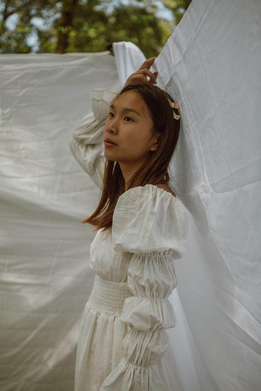girl in white dress standing