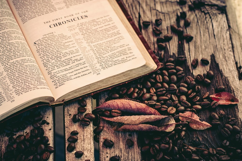 white book page with coffee beans