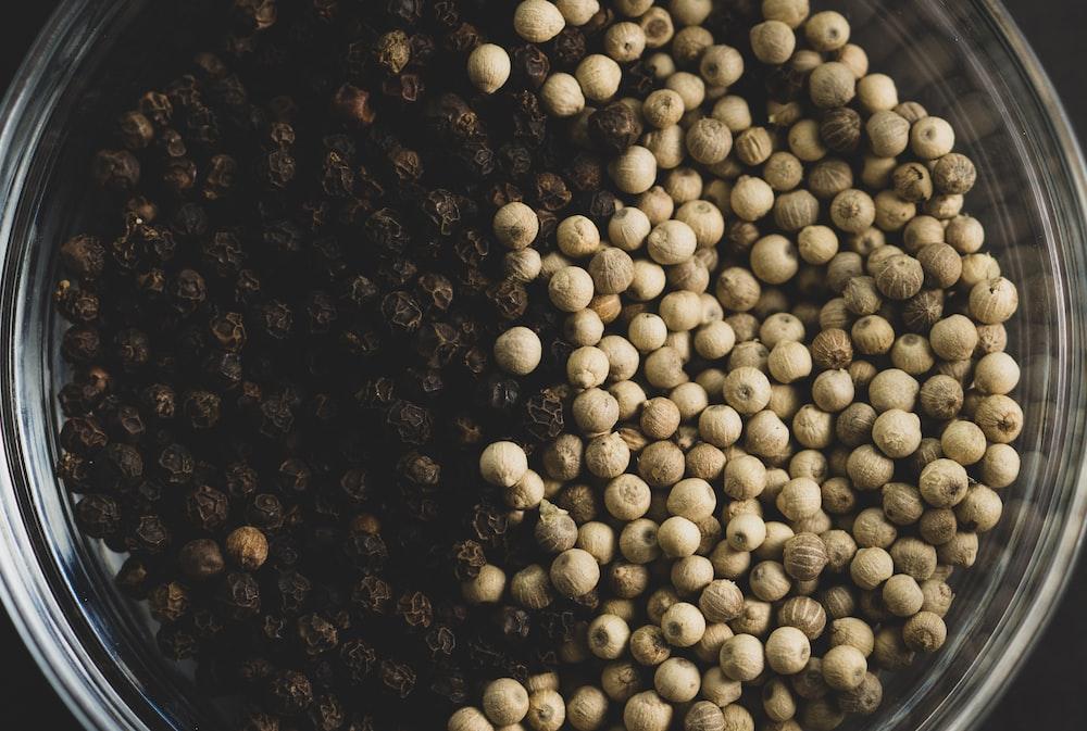 white round balls on black background