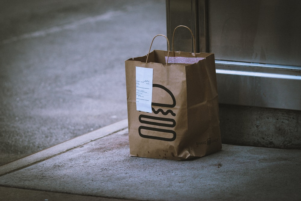 brown paper bag on gray concrete floor