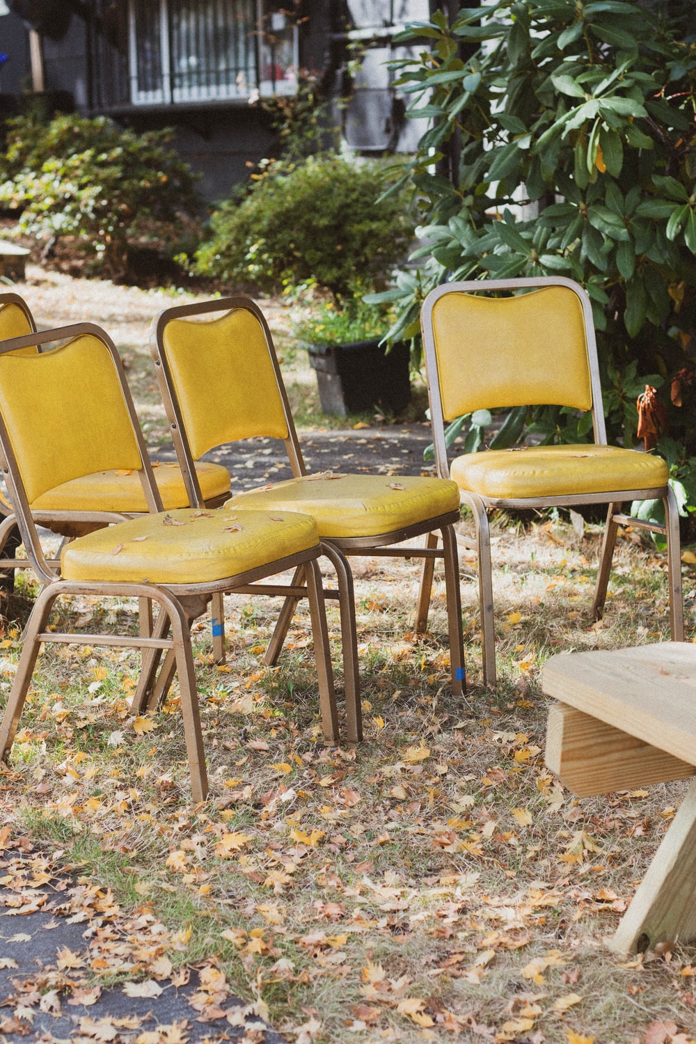yellow and brown wooden chair