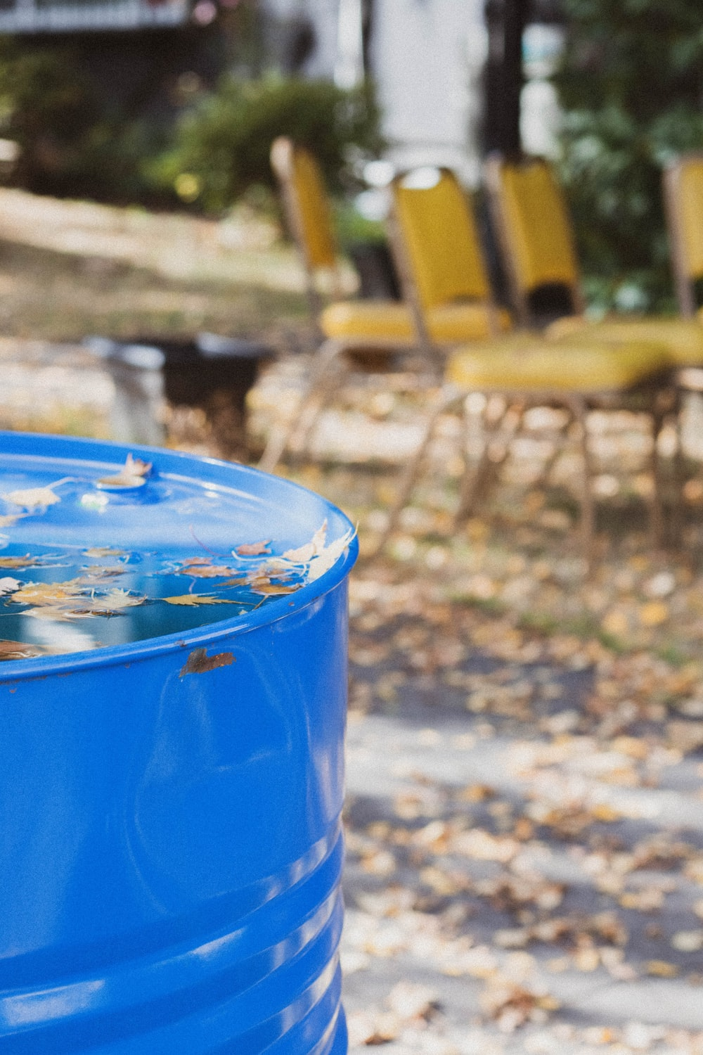 blue plastic bucket on brown wooden table
