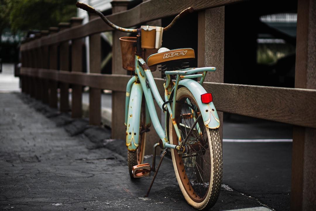 Green City Bike Parked On Sidewalk During Daytime - unsplash