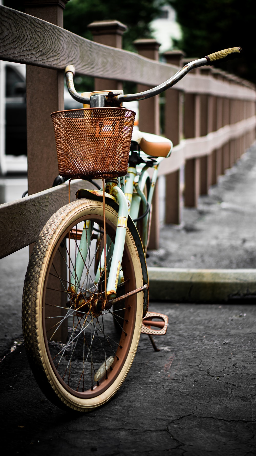 brown city bike on gray concrete road during daytime