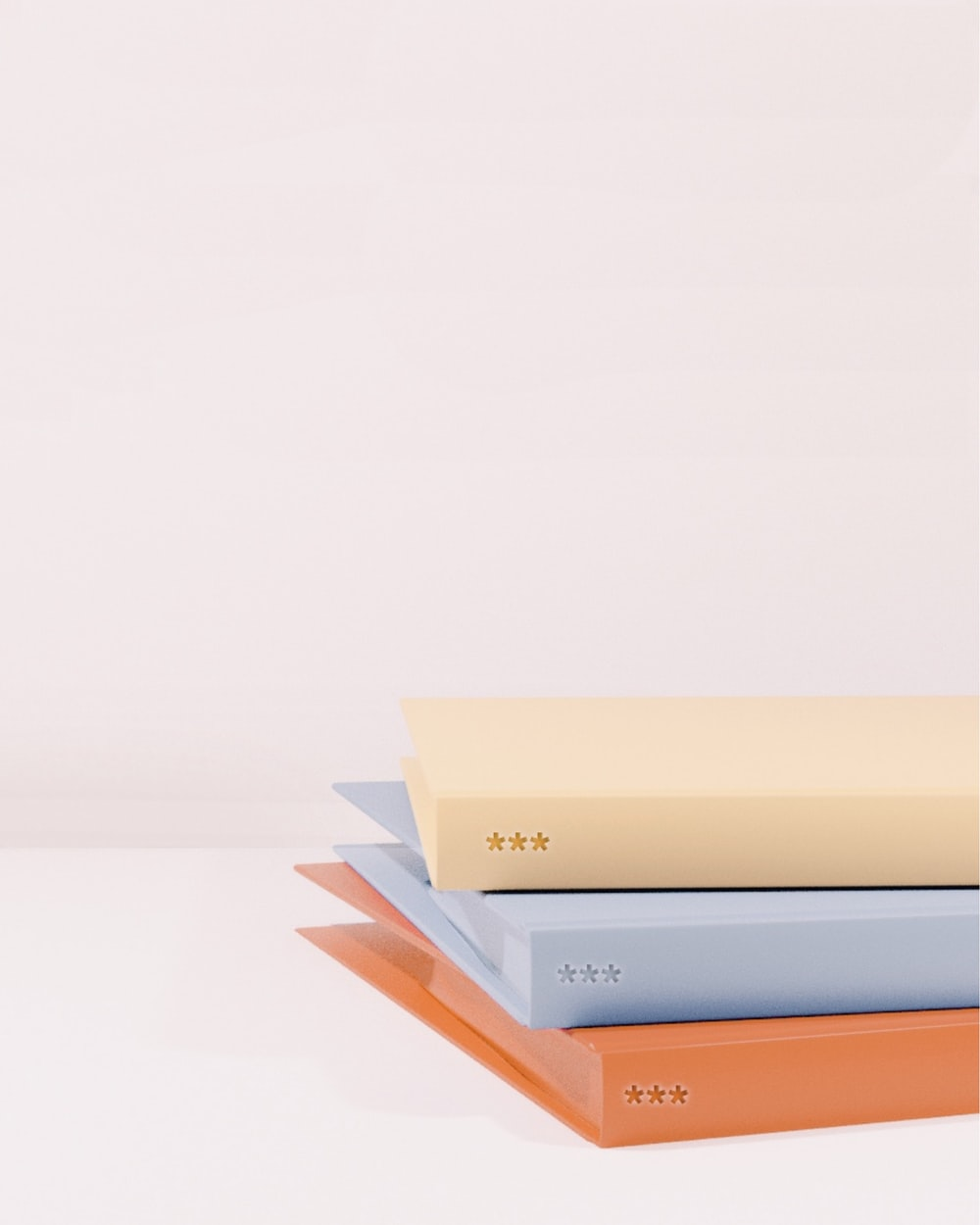 stack of books on white table
