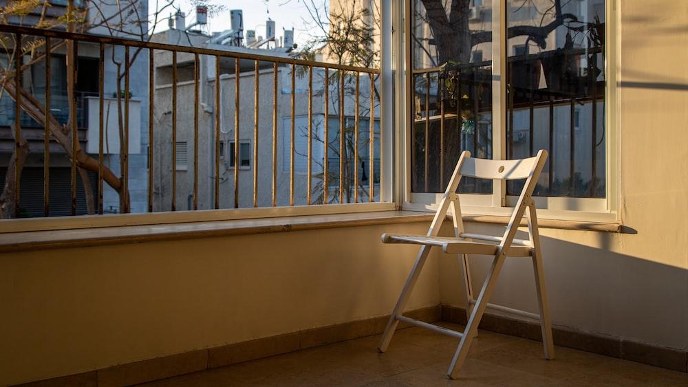 white wooden table beside window