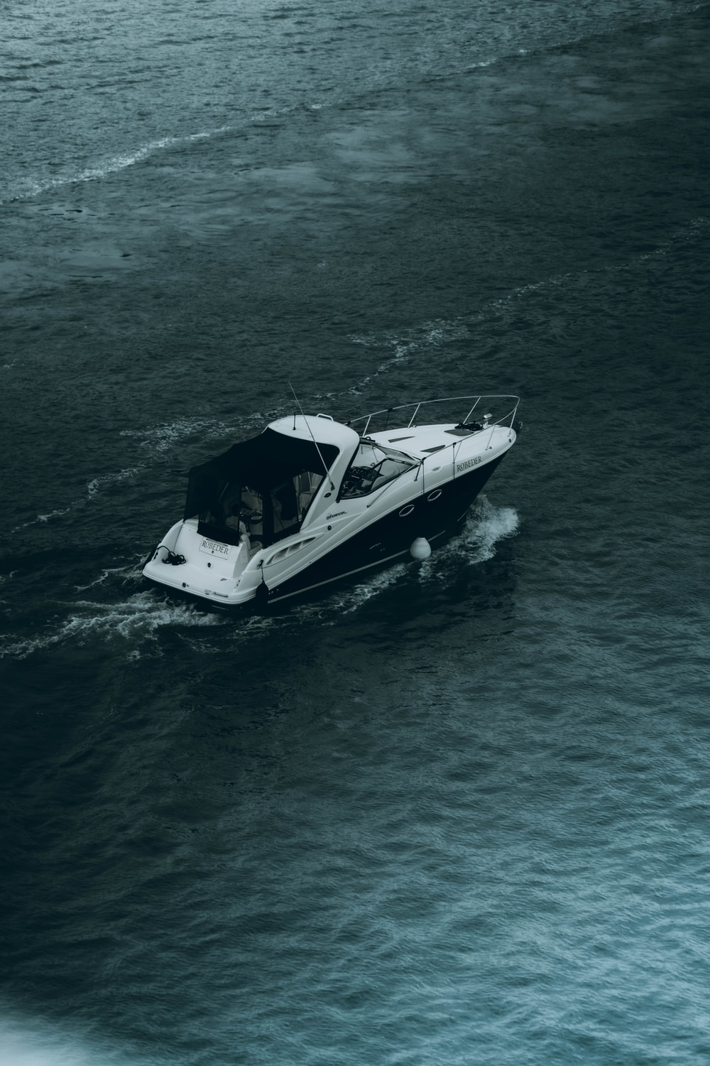 white and black yacht on sea during daytime