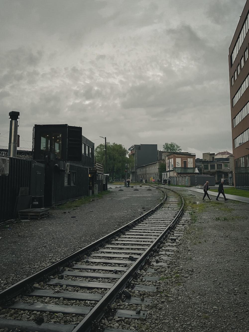 train rail near building during daytime