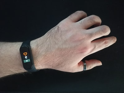 smart watch with heart rate monitor in male hand