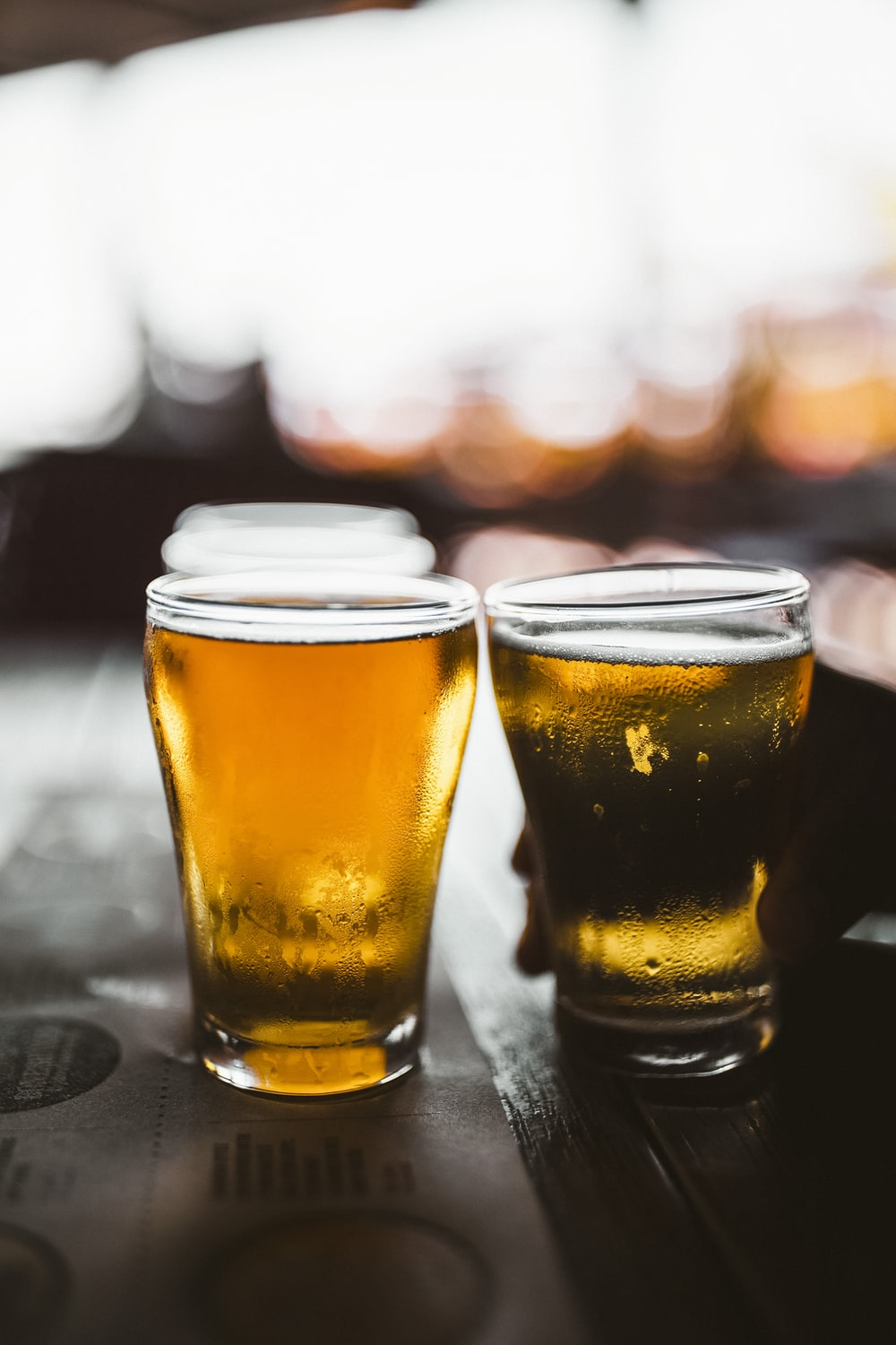 clear drinking glass with beer on black table