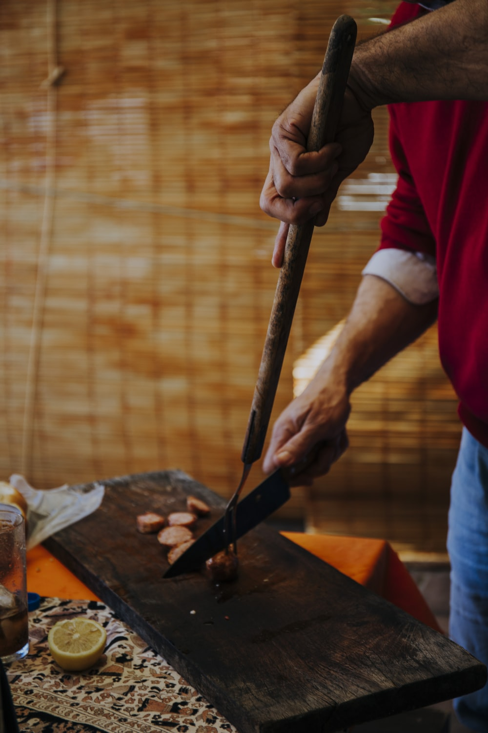 person holding knife slicing meat