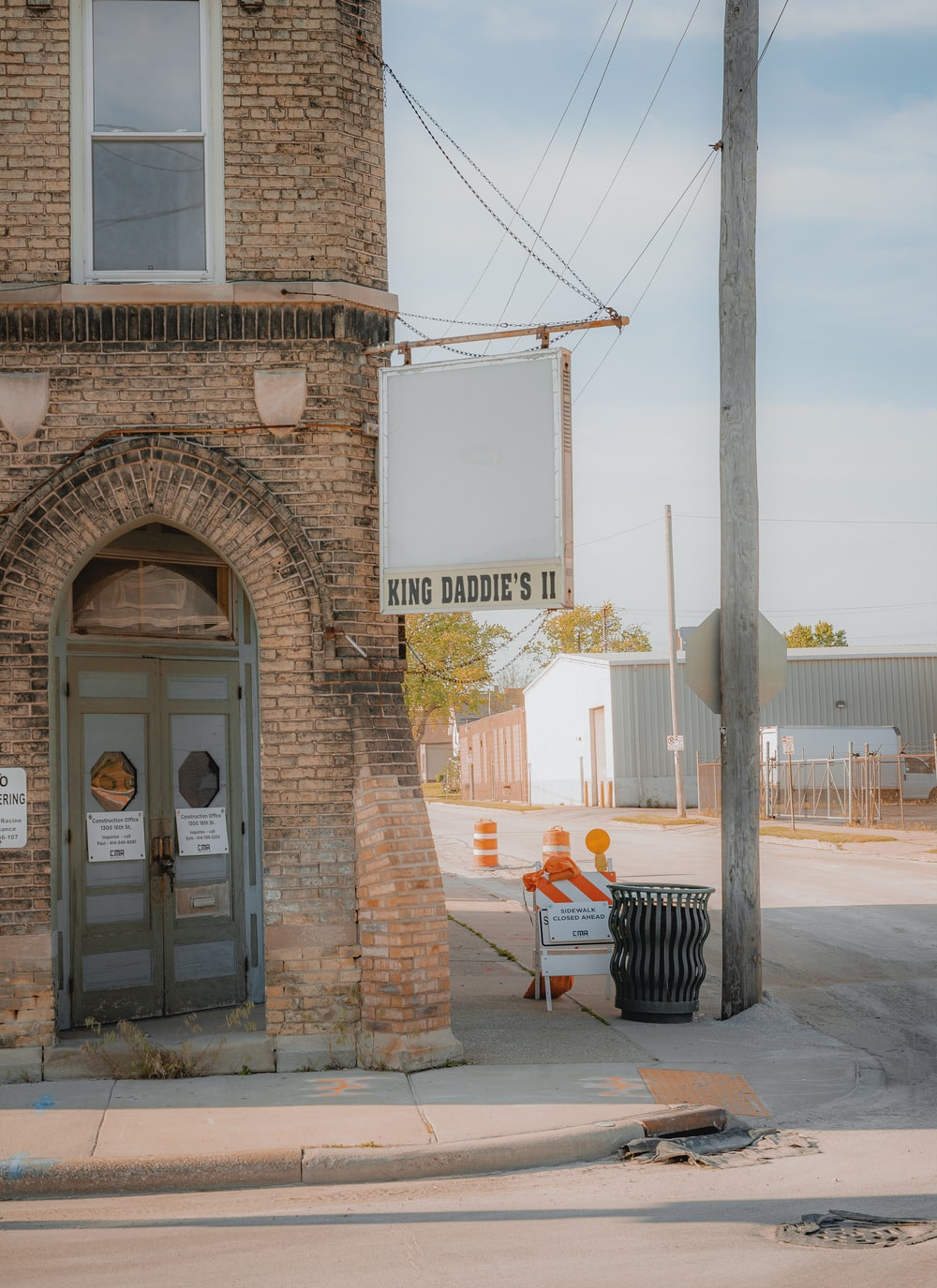 brown brick building with glass door
