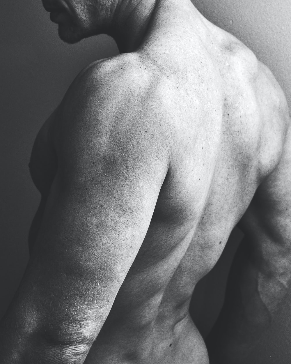 grayscale photo of naked man