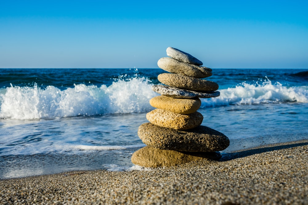 stack of stones on beach during daytime