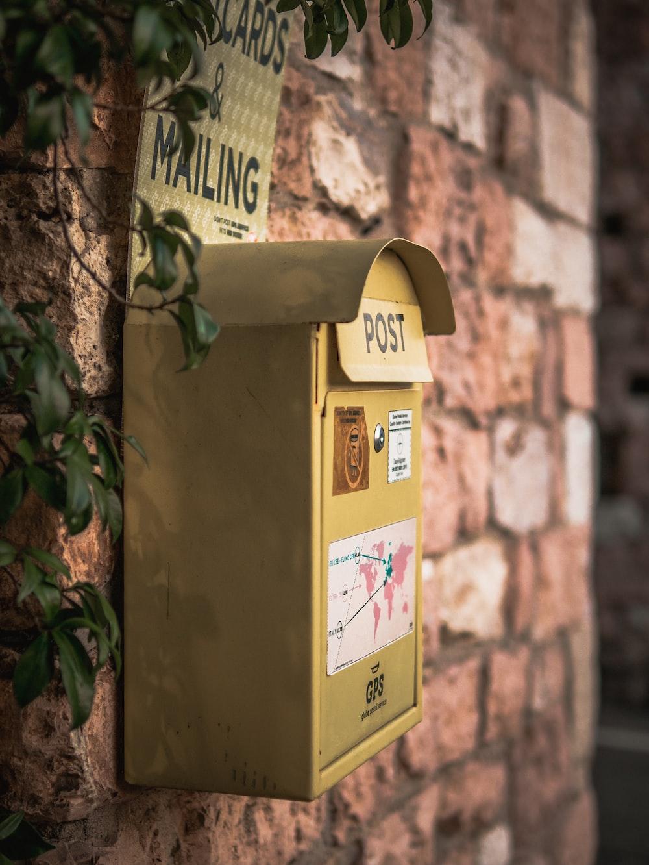 yellow and white mail box