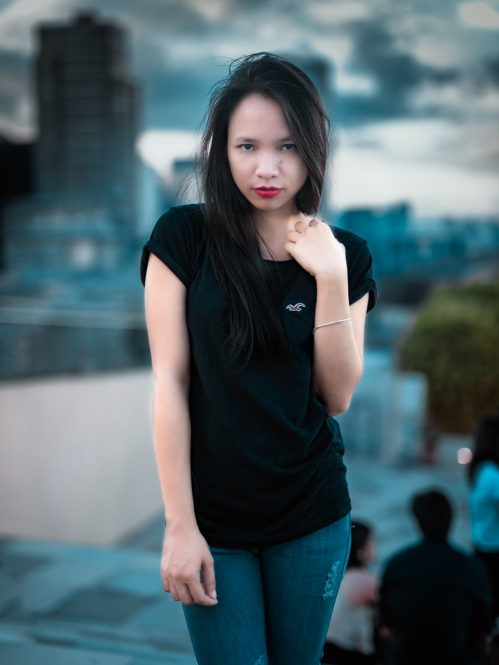 woman in black crew neck t-shirt and blue denim jeans