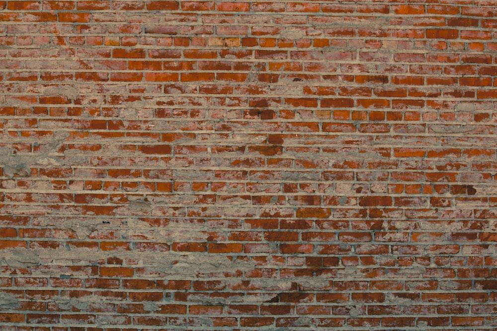 brown brick wall during daytime