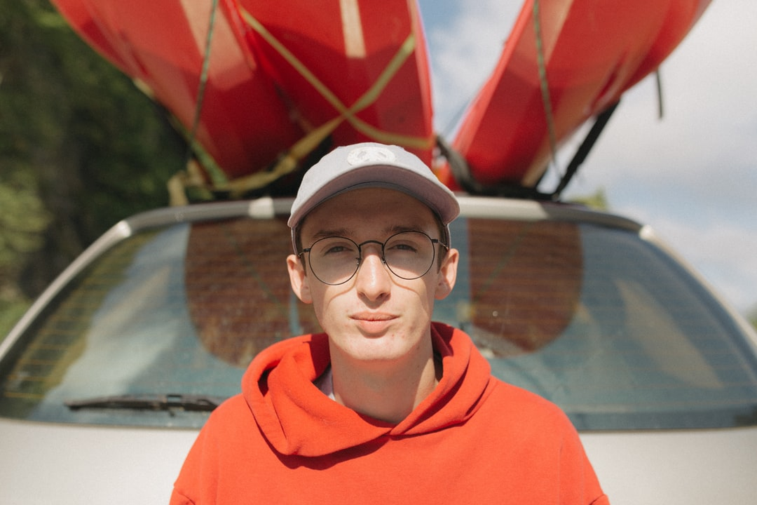 Boy In Red Hoodie Wearing Black Framed Eyeglasses - unsplash