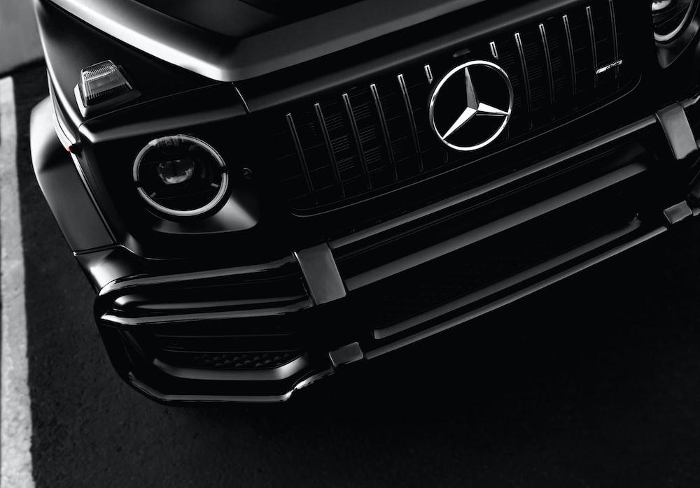 black mercedes benz car steering wheel