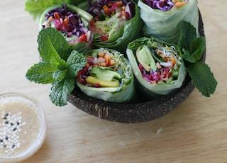 Coconut bowl full of fresh spring rolls