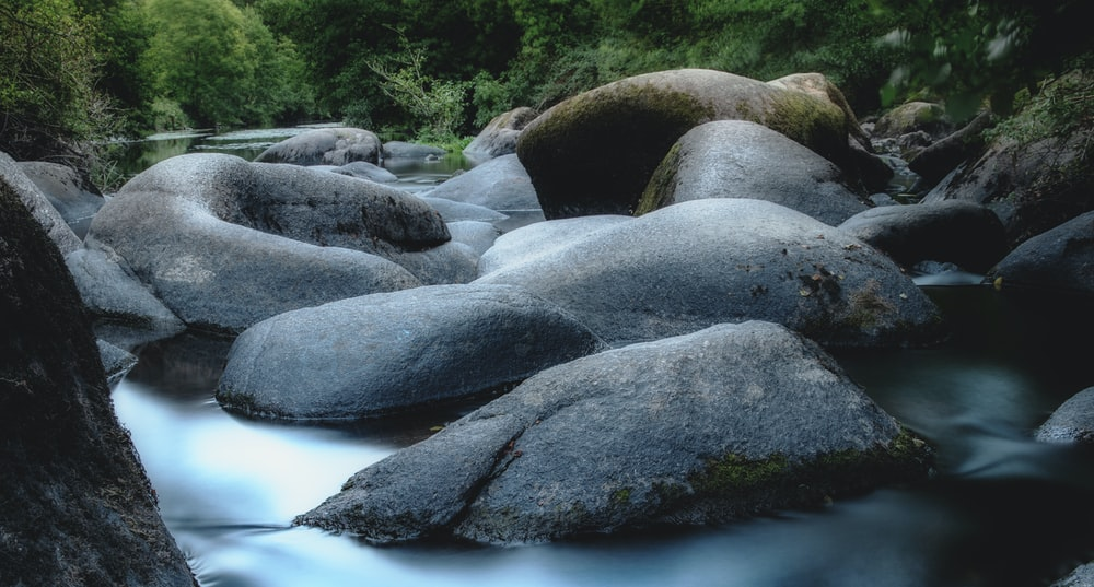 gray rocks on river during daytime