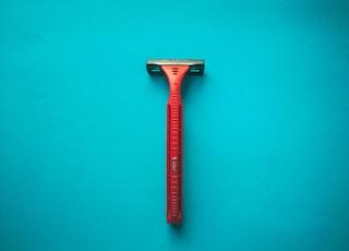 Orange razor on a turquoise background