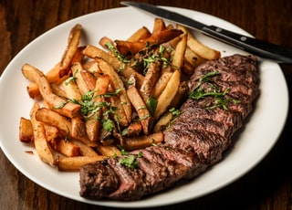 Some beautiful bastard cut up this delightful steak for me to photograph with truffle oil fries on the side. Part of the C9 Work WordPress Theme sample content imagery.