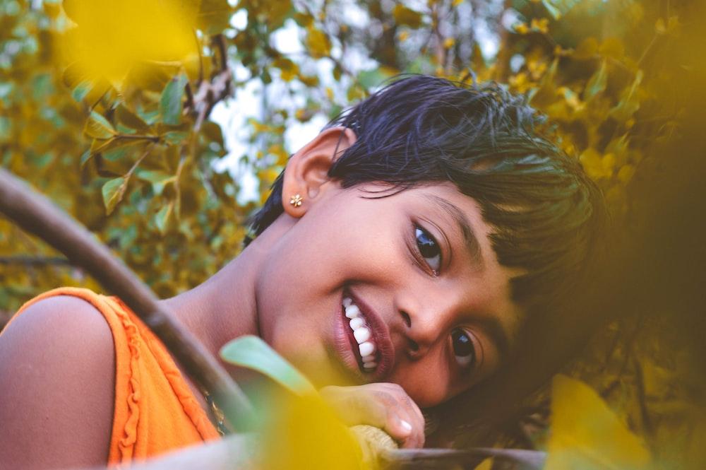 smiling woman in orange shirt