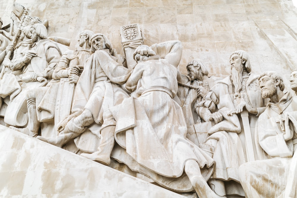 man and woman concrete statue