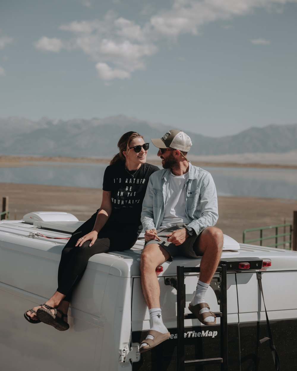 man in black crew neck t-shirt sitting on white boat during daytime