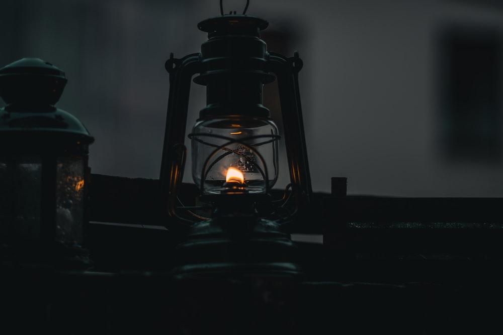 black lantern lamp on table