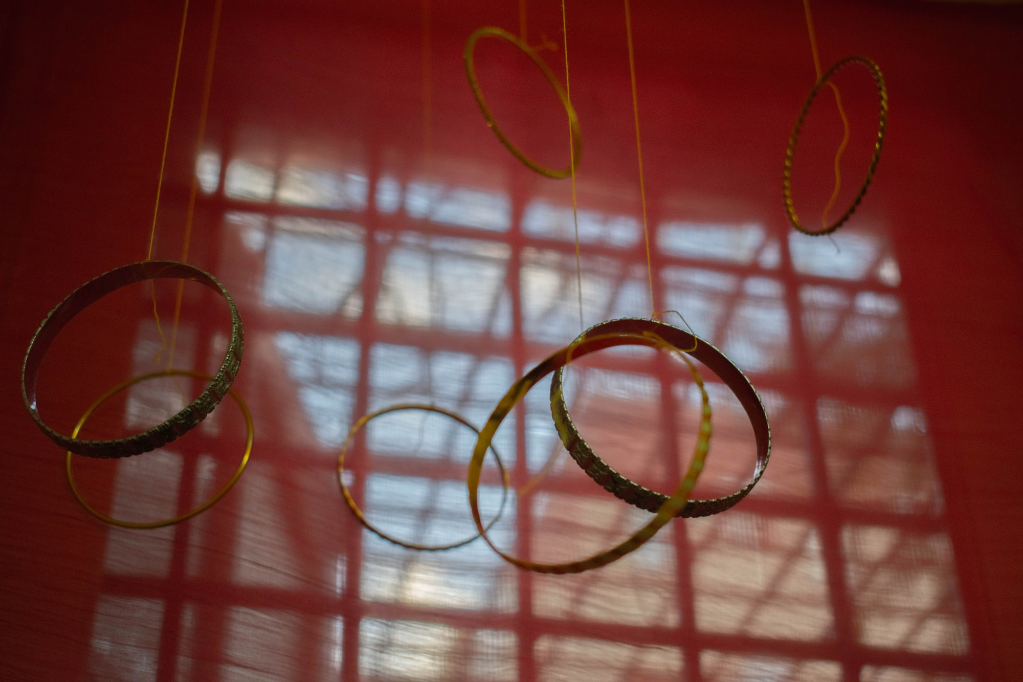 A bunch of bangles hang from a thread in the ceiling to denote a wedding in India