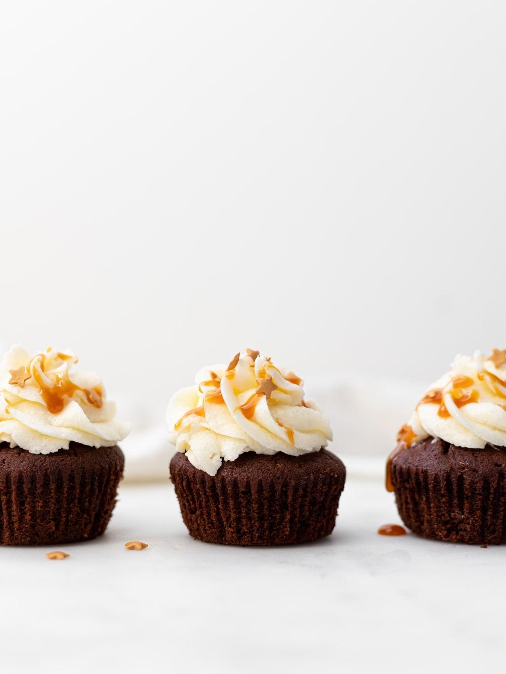 three cupcakes on white surface