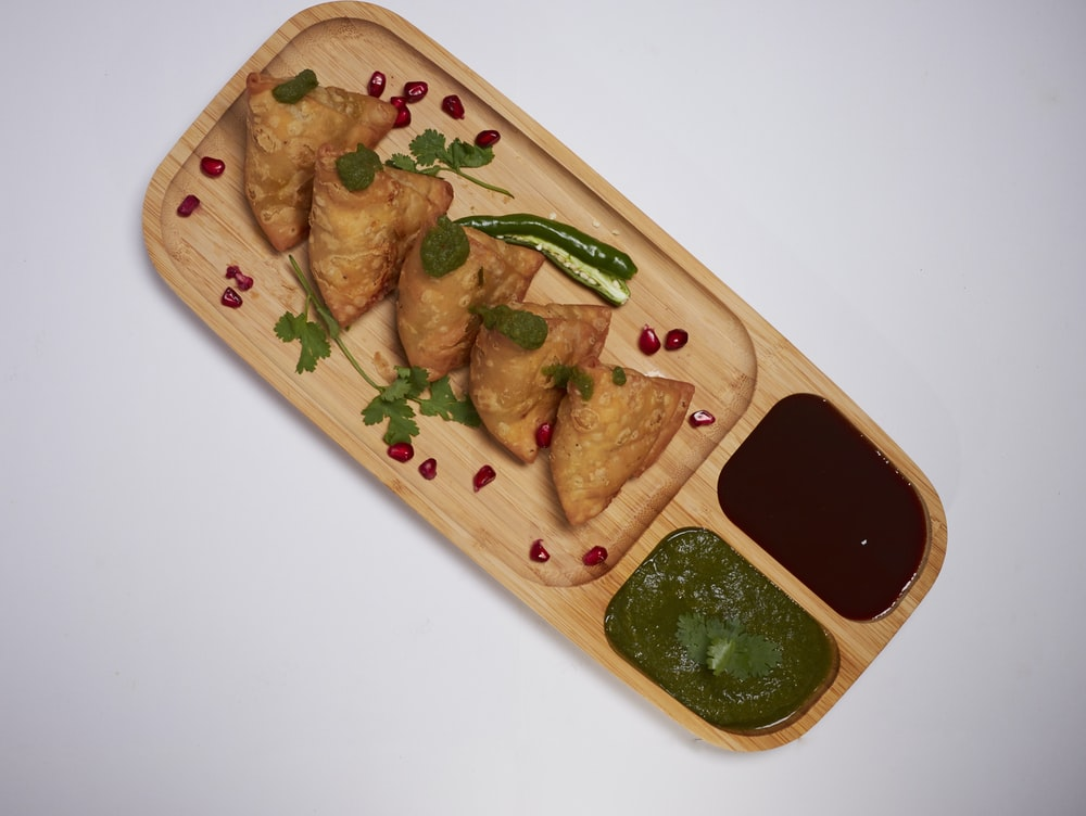 brown wooden tray with food