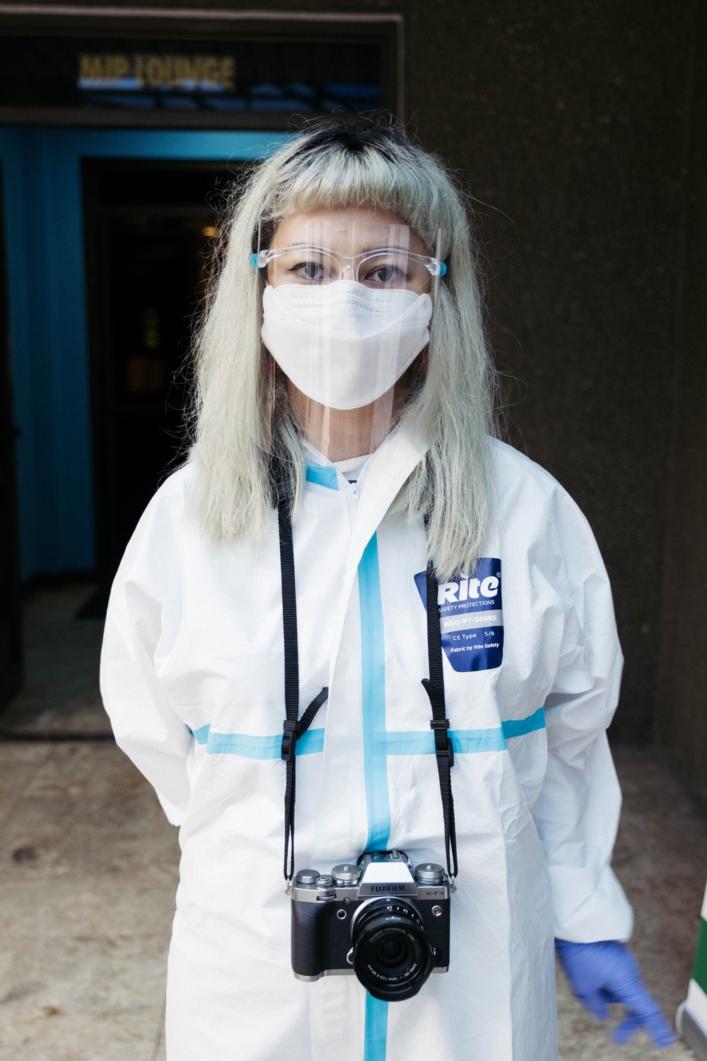 woman in white long sleeve shirt wearing white face mask