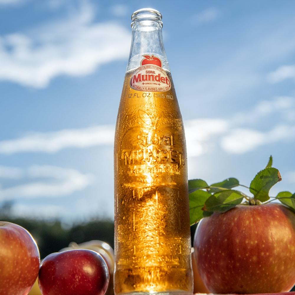 red apples and orange juice bottle