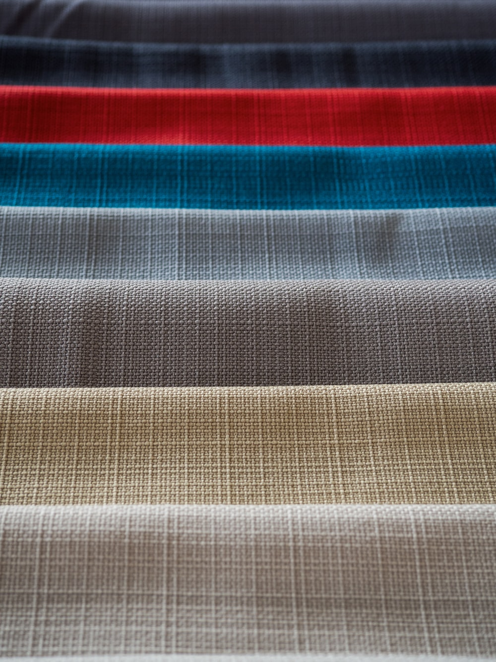 red white and black striped textile