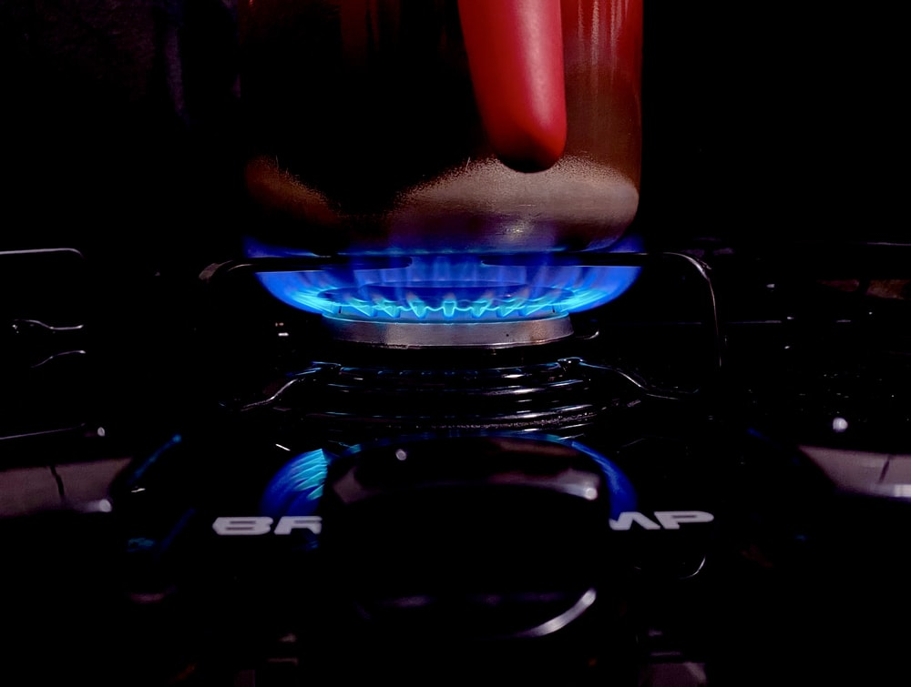 blue and red lighted gas stove