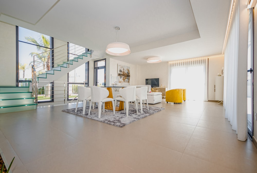 white chairs and table on white floor tiles